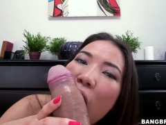 Asian moves her hand up and down over dudes dick